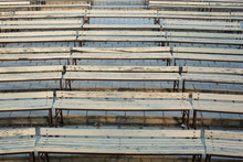 Row Of Wooden Benches At Summe...