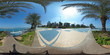 360 degrees spherical panorama of the abu dhabi (UAE) corniche with view of the skyline an blue water