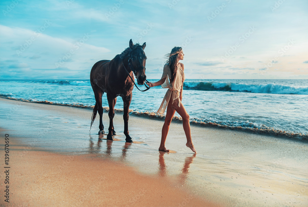 Fototapety, obrazy: Slim young lady walking with a horse pet