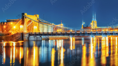 Foto op Canvas Brug Old Grunwaldzki bridge over Oder river, Wroclaw. Beautiful dramatic Night scenery.