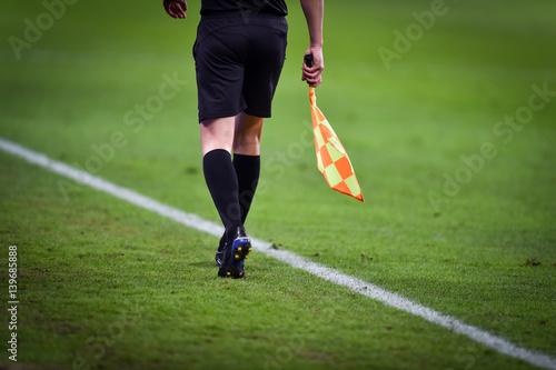 Assistant referee moving along the sideline during a soccer match Canvas Print