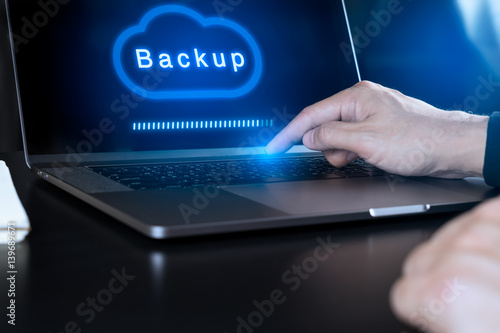 Businessman hand using modern laptop computer to Backup on Cloud Canvas Print