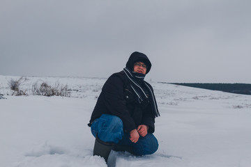 Fototapeta na wymiar traveler walking in a winter steppe