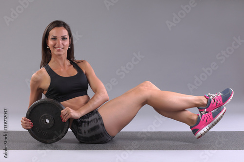 Women Doing Exercise Abdominal Crunches Pumping A Press On Floor