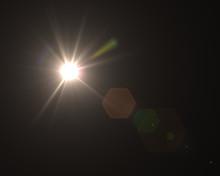 Realistic Digital Lens Flare In Black Background