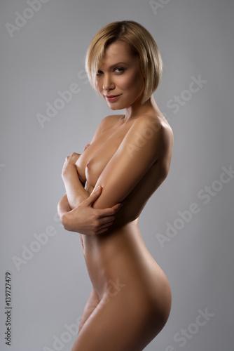 Nude blonde artistic studio portrait