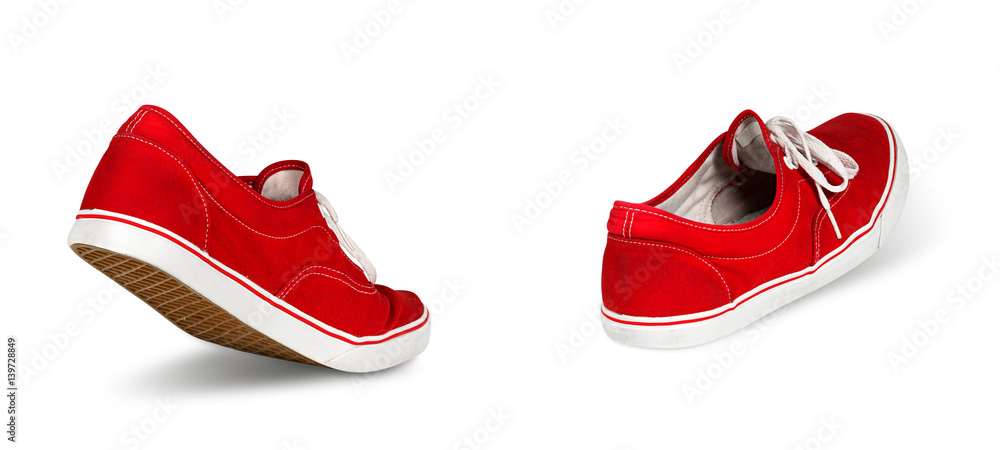 Fototapeta empty red ghost shoe sneaker walking away isolated on white background / Geisterschuhe rot laufen gehen isoliert