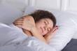 Beautiful girl sleeping in bed alone.