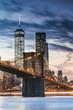 Brooklyn bridge and lower Manhattan skyline at dusk, New York city, USA