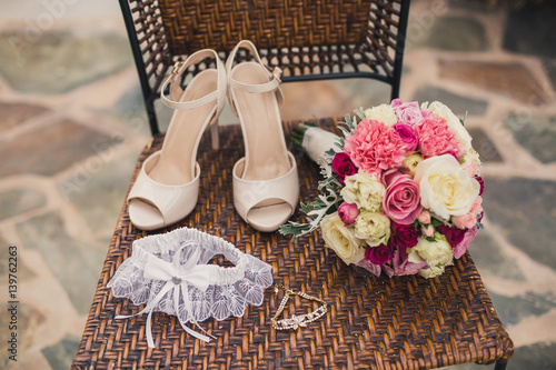 Fototapeta  bride's accessories on a chair