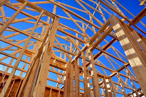 Fotografia, Obraz  Wood frame residential structure under construction.