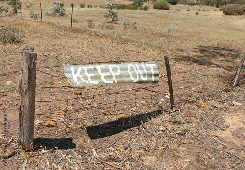 Poster  Keep Out sign painted on corrugated iron in Australia