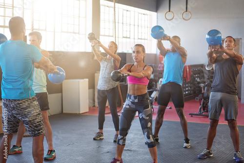 Fotografie, Obraz  Group kettle bell class in bright sunlit gym