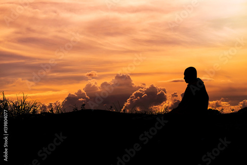 Fotografie, Tablou Silhouette - The Buddhist Monk Meditation and clouds evening sky