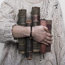 Person Holding Carrying Old Vintage Antique Books