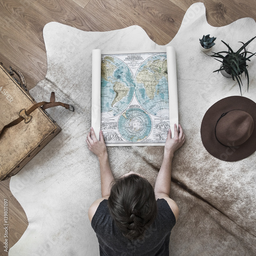 Woman looking at map of the world