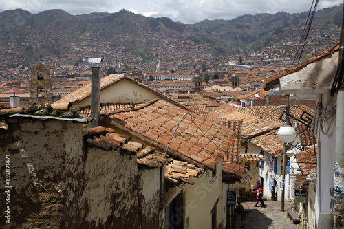 Street scene in San Blas neighborhood with a view over the rooftops of Cuzco, Peru.