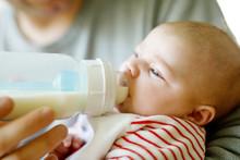 Father Feeding Newborn Baby Da...