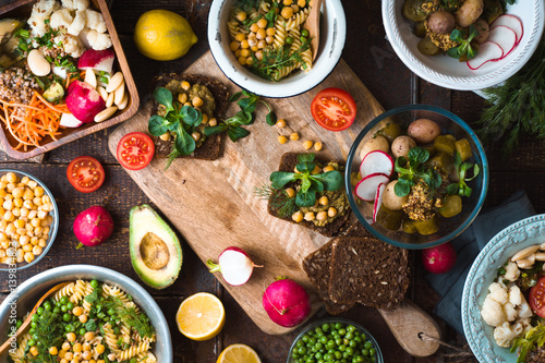 Feast with various salads and sandwiches Fototapeta