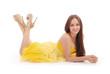 Beautiful woman with brown hair in elegant yellow dress