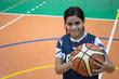 Teenager student girl with a basket ball