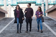 Three students walking in the campus