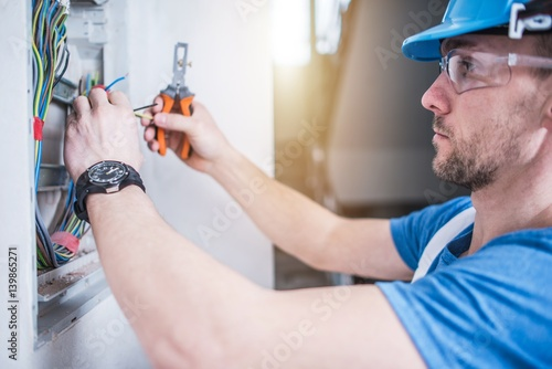 Fotografie, Obraz  Electric Technician Job