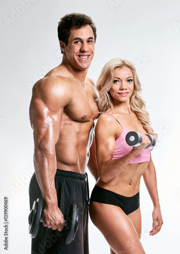 Fototapety, obrazy: Sporty couple with dumbbells