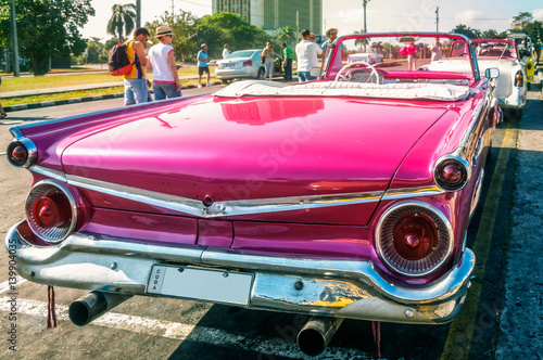 Keuken foto achterwand F1 Havana, Cuba -March 14, 2016 - Back detail of a bright colored vintage classic American car parked near Revolution Square, Cuba.