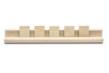 Five Blank Scrabble Tiles On A...