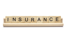 Word ''insurance'' On Scrabble Wooden Letters On A Rack, Isolated On White Background.