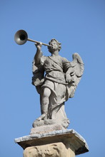 Statue Of Angel Playing The Horn