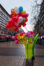 A Woman Selling Balloons At A ...