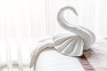 Beautiful Swan From White Bath Towel Decorate On Bed Corner, Nice Greeting From Hotel.