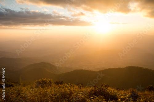 Sunset at the Mountain Hill,Beautiful sunlight, Golden lights background