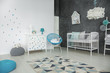 Bright baby bedroom with cot