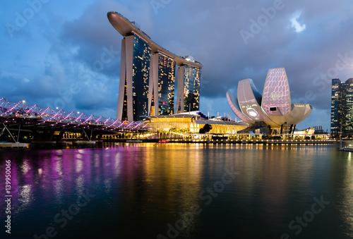 Tuinposter Singapore MARINA BAY, SINGAPORE - Mar 3, 2017: Singapore Art Science Museum light up in accordance to iLight Marina Bay- Asia's leading sustainable light art festival, held in the Marina Bay, Singapore.