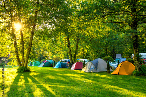 Fotobehang Kamperen Tents Camping area, early morning with sunshine