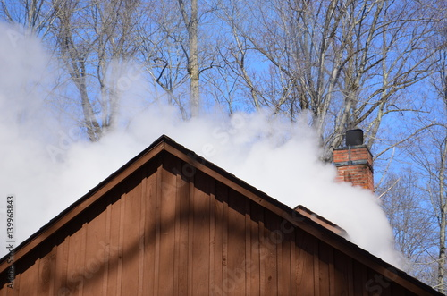 Fotografering  Steam billowing from a maple syrup sugar shack