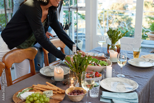 Host Hostess Woman Setting The Table For Dinner Party With Friends Candles Plants