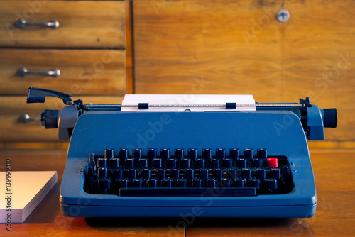 Papiers peints Retro old blue retro typewriter in a antique wooden room, writing letter