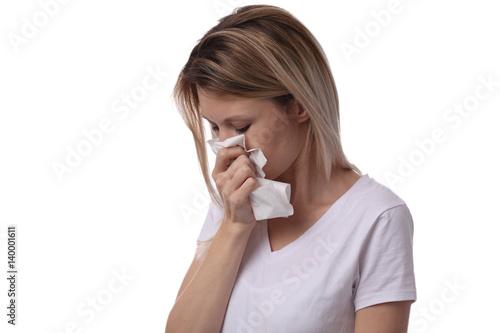Valokuva  Woman sneezing and holding tissue isolated on white background