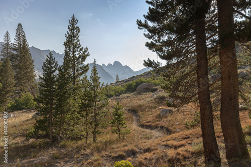 Fotografie, Obraz  Alpine Mountain Trail - A winding high alpine mountain trail leading to granite mountain in the background on the Pacific Crest Trail