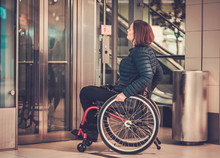 Disabled Woman Waiting For Elevator In A Store