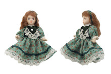 Porcelain Doll In Green Dress. Isolated Porcelain Doll In Green Dress Front And Angle View Photo.