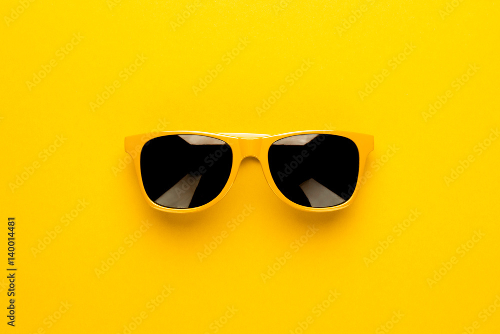 Fototapeta studio shot of yellow sunglasses. summer is coming concept