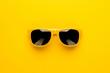 Leinwandbild Motiv studio shot of yellow sunglasses. summer is coming concept