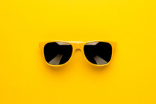 Studio Shot Of Yellow Sunglass...