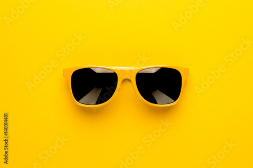Leinwand Poster studio shot of yellow sunglasses. summer is coming concept