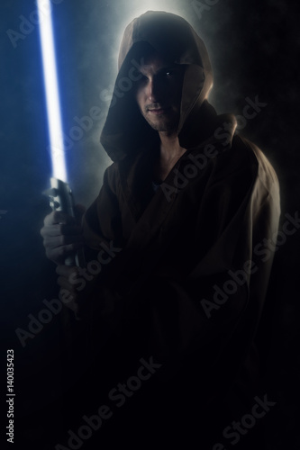 Fotografie, Tablou  Young warrior holding a lightsaber